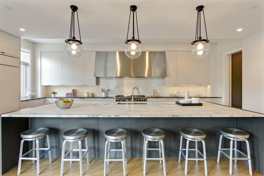 LG Construction + Development 14-foot long kitchen island ...