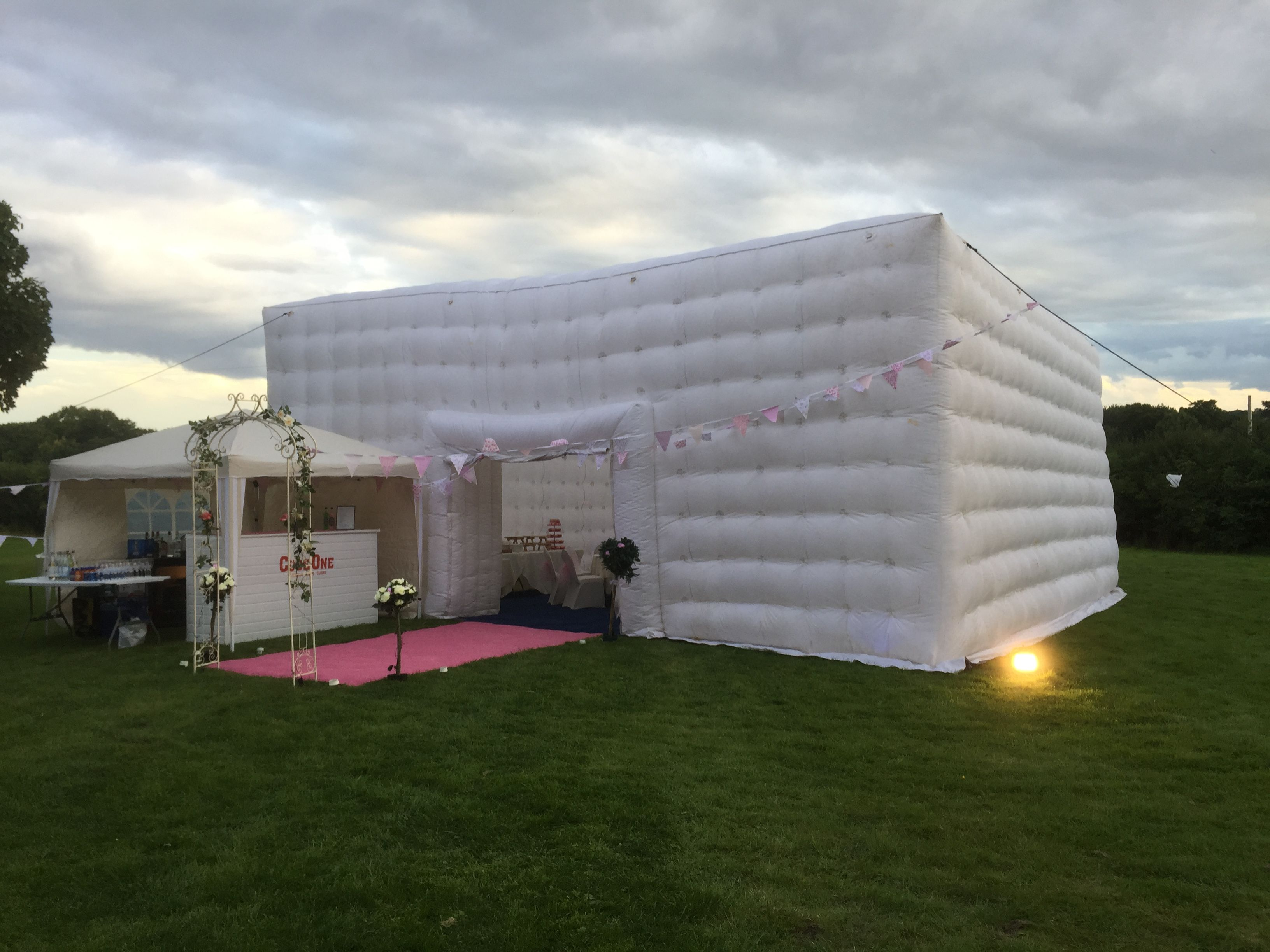 10m x 10m cube with baby pink themed entrance wedding arch and exterior bar!
