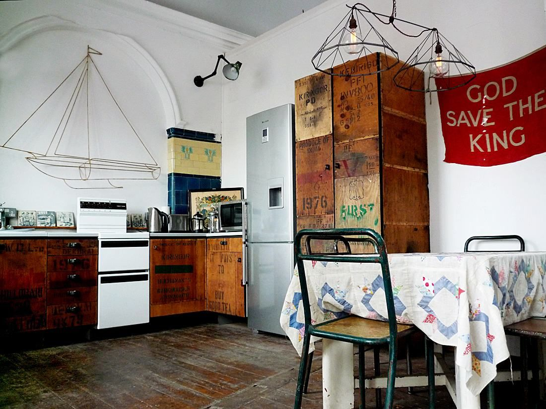 Love the old packing crates up-cycled into kitchen cupboards
