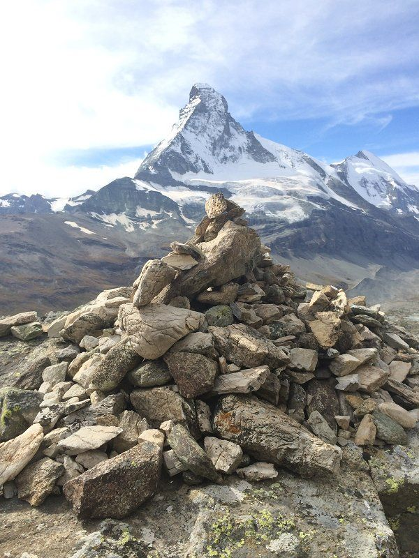 A pile of rocks in front of the Matterhorn at Zermatt, Switzerland ...