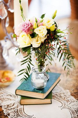 Charming vintage books as centerpieces; Calli B photography