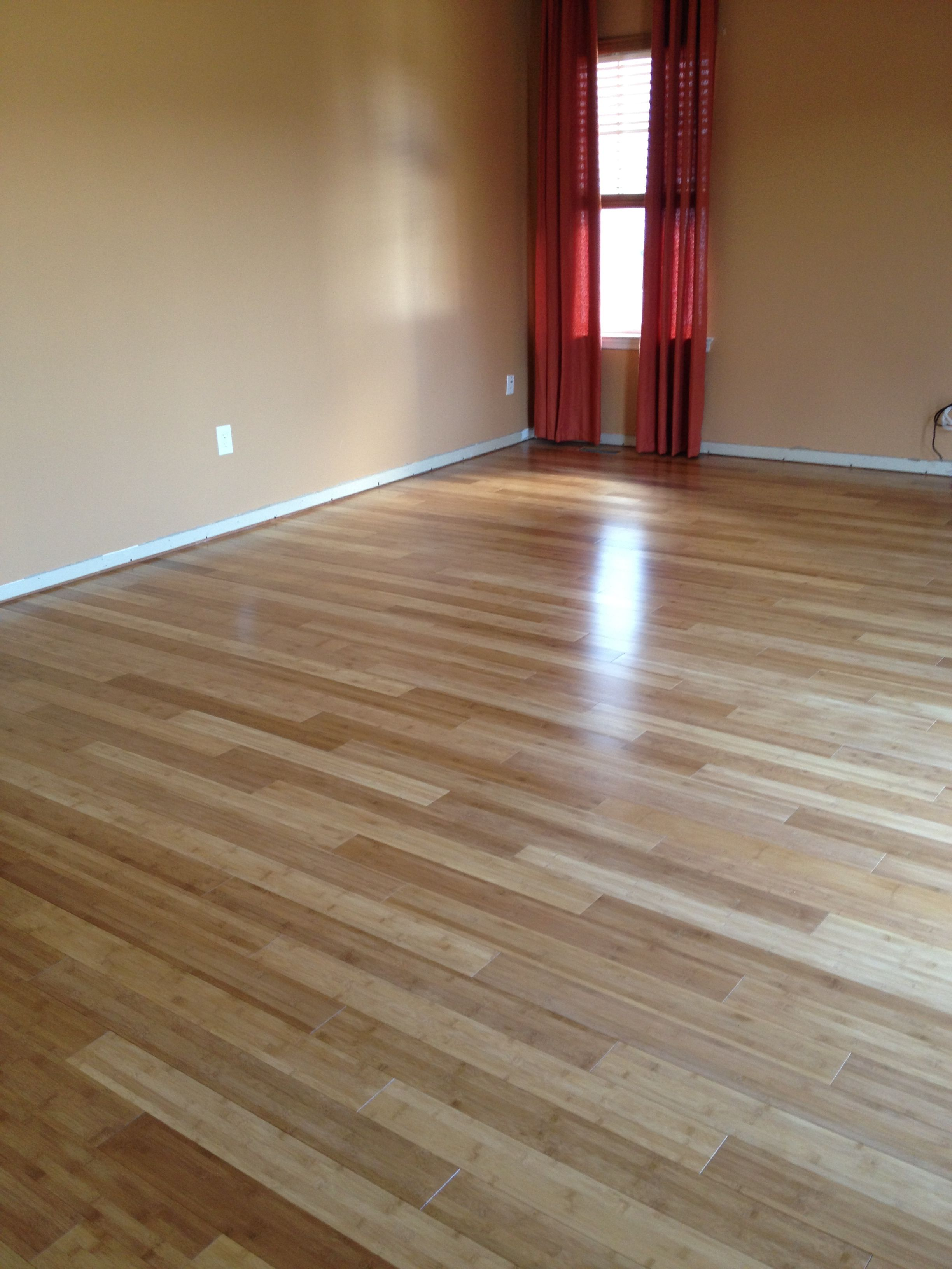 Solid bamboo flooring. I like this lighter tone for the ...