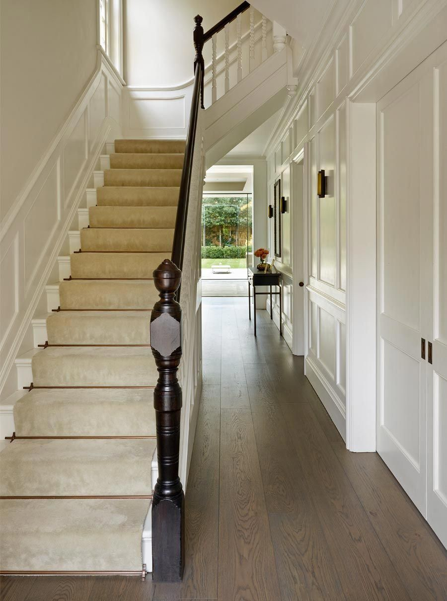 Smoked Oak Flooring In Painted Wood Panelled Hallway Showing Staircase With Bronze Stair Rods And Dark Stained Handrail Panelingwallsstaircase
