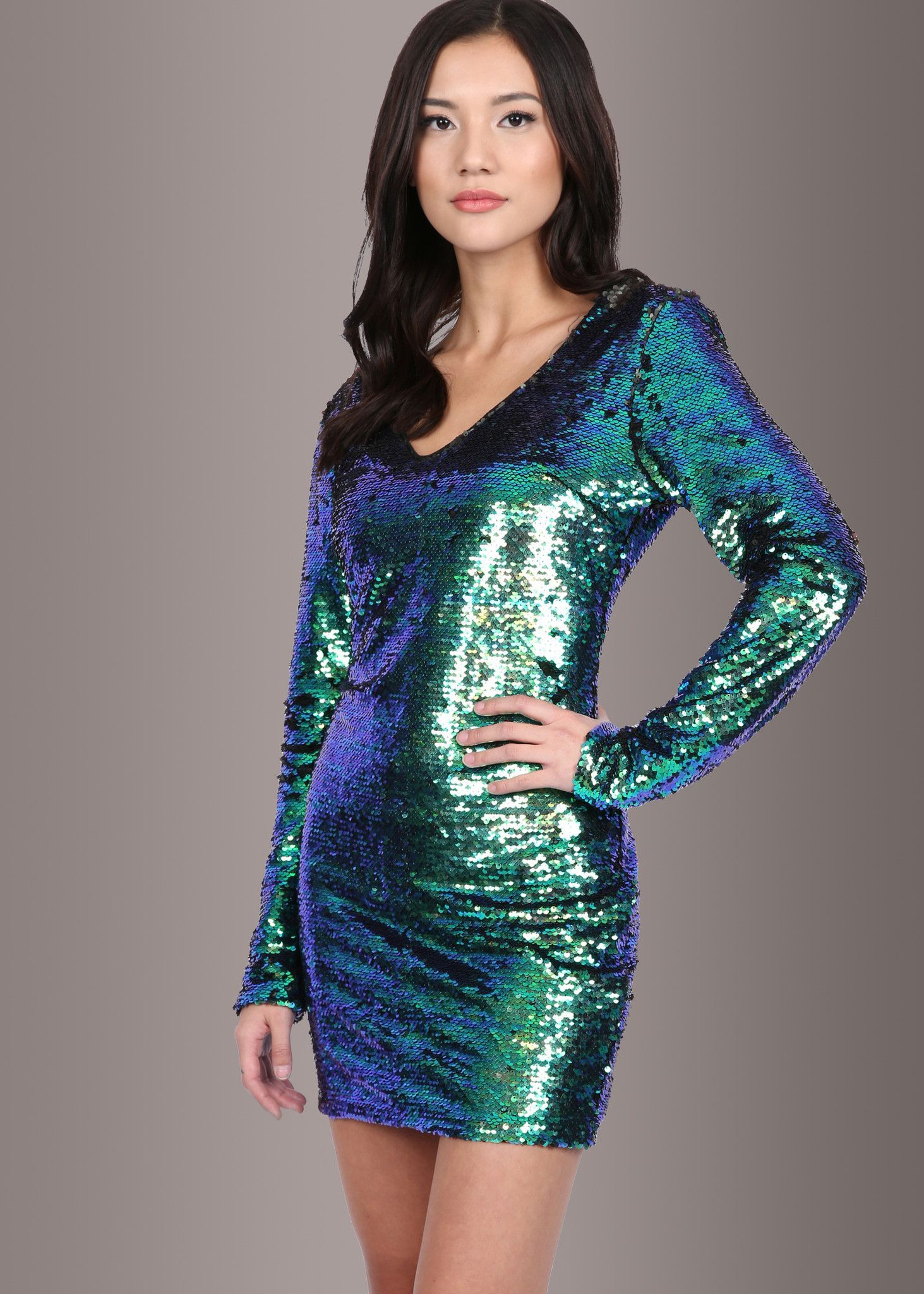 1484ca47a5 Steal the scene in this stunning sequined dress! This sparkling beauty  showcases blue and green mermaid colored sequins allover.