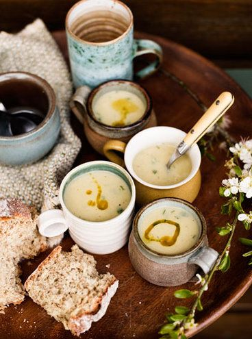 awesome mugs + soup (which means it's probably cool outside) + bread + some kind of neat textile + neutrals with a bit of blue and yellow = pretty much my favorite picture ever
