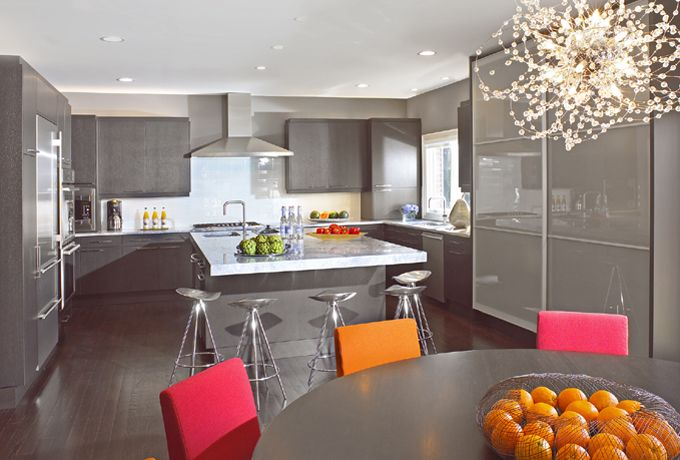 A clean contemporary kitchen. A soft gray palette is paired with white subway glass tiles that glisten. Stainless and gray/white granite add to the richness and sleek design. Tamara Kessler & Assoc Inc