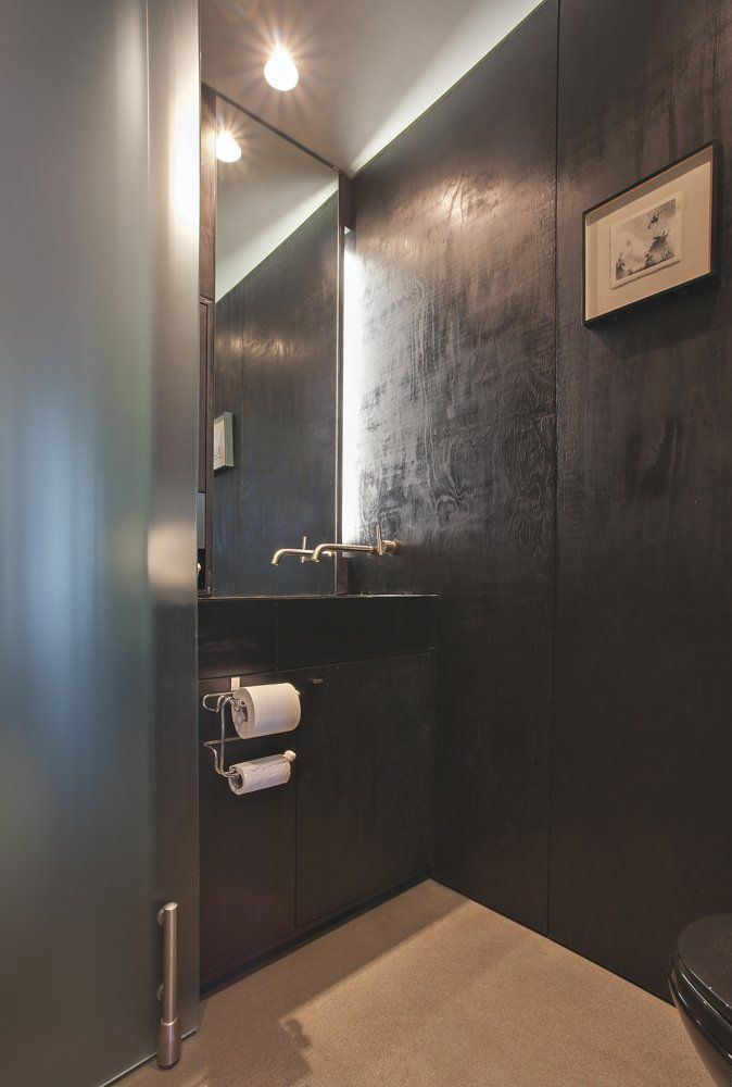 plywood walls painted with black gloss - cool!