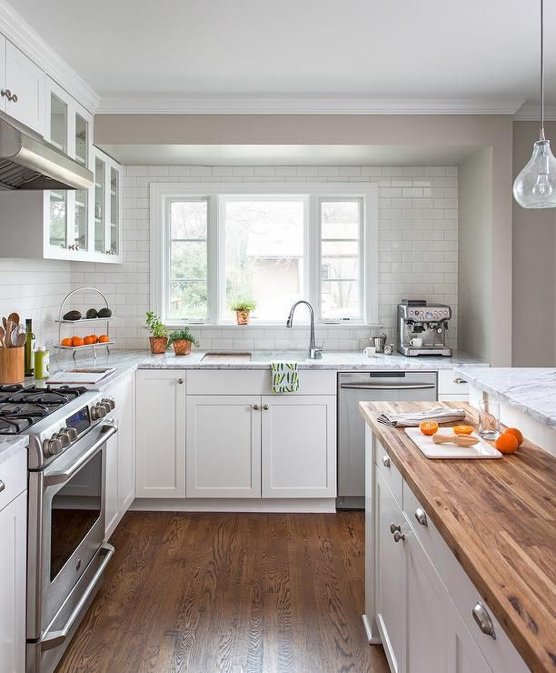 Kitchen Flooring And Backsplash: White Kitchen Features White Shaker Cabinets Adorned With