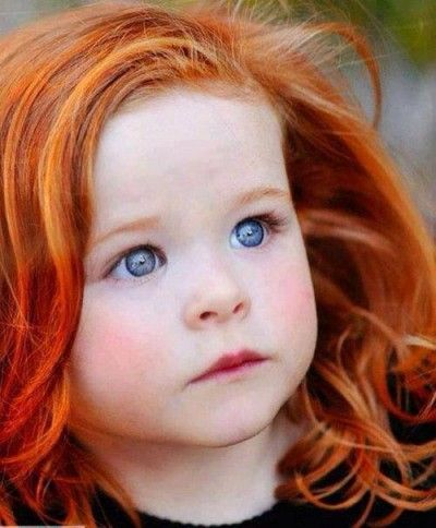 Remarkable, redhead girl with red eyes