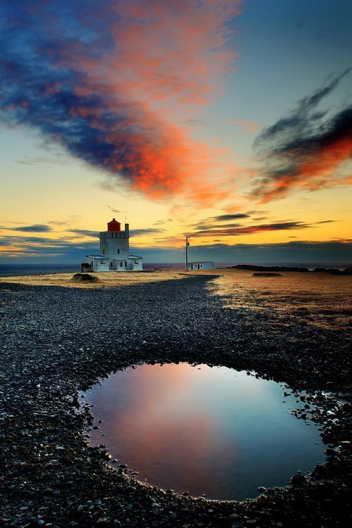 The lighthouse. Photo by Francesco Russo - Lighthouse in the black beach near Vik, Iceland