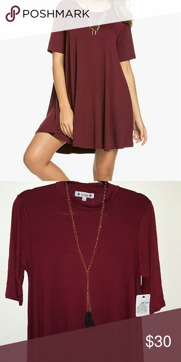 New with tags swing dress with necklace Cute burgundy swing dress. Pullover style, half sleeves, mock neckline. Hits above knee. First Image taken from Internet for show only. Dresses