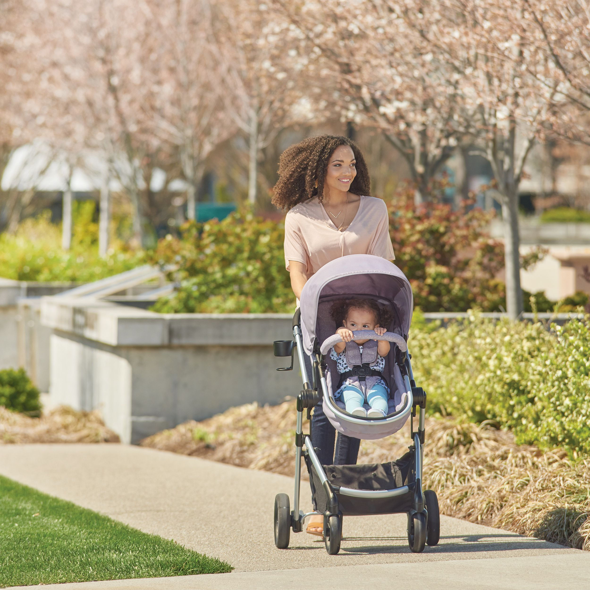 Summertime strolling with the Evenflo Pivot Travel System