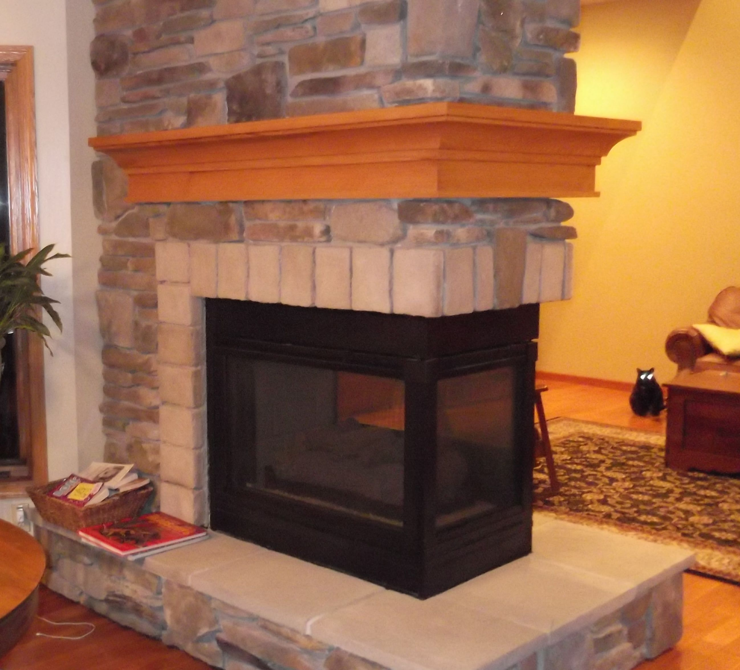 two sided corner fireplace with mantel fireplace and mantel