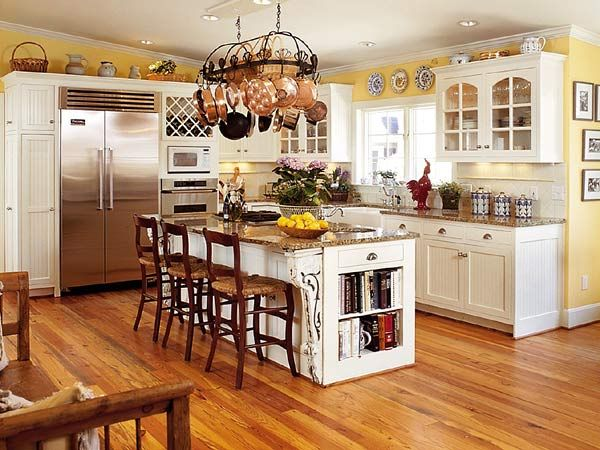 white cabinets, yellow walls, and open cabinets. especially love the pot  rack above the island!