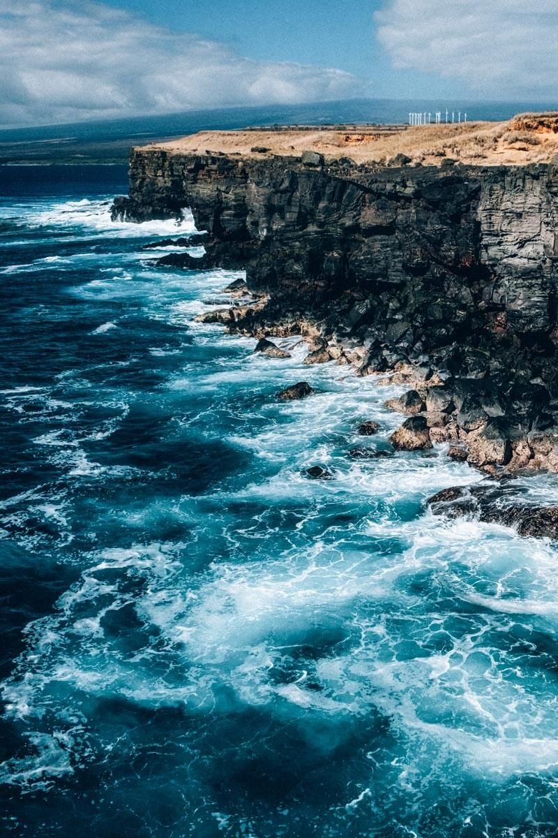 Cliff jumping Hawaii Big Island style can only be done at South Point Hawaii. These Hawaii cliffs are an amazing site, even if you don't want to jump. #thebigisland #hawaii #bigisland #beaches #avenlylane #avenlylanetravel #avenlylanehawaii