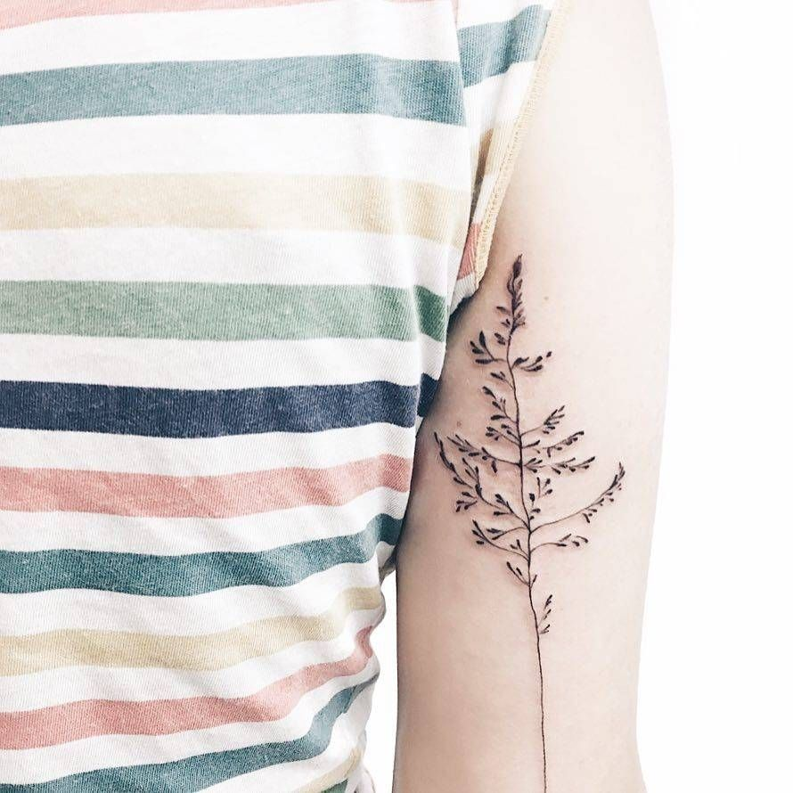 Grass tattoo on the back of the right arm. | Tricep Tattoos | Pinterest