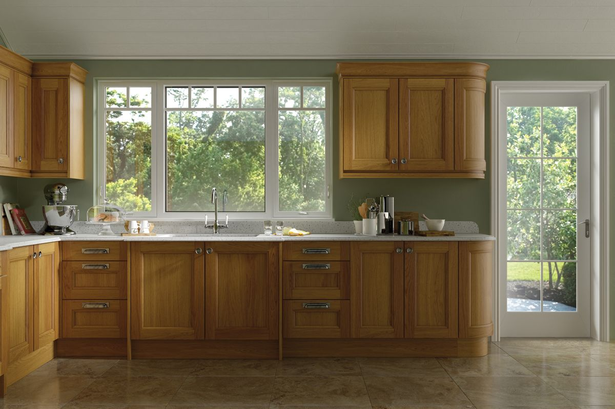 family kitchen with valence grid windows and patio door