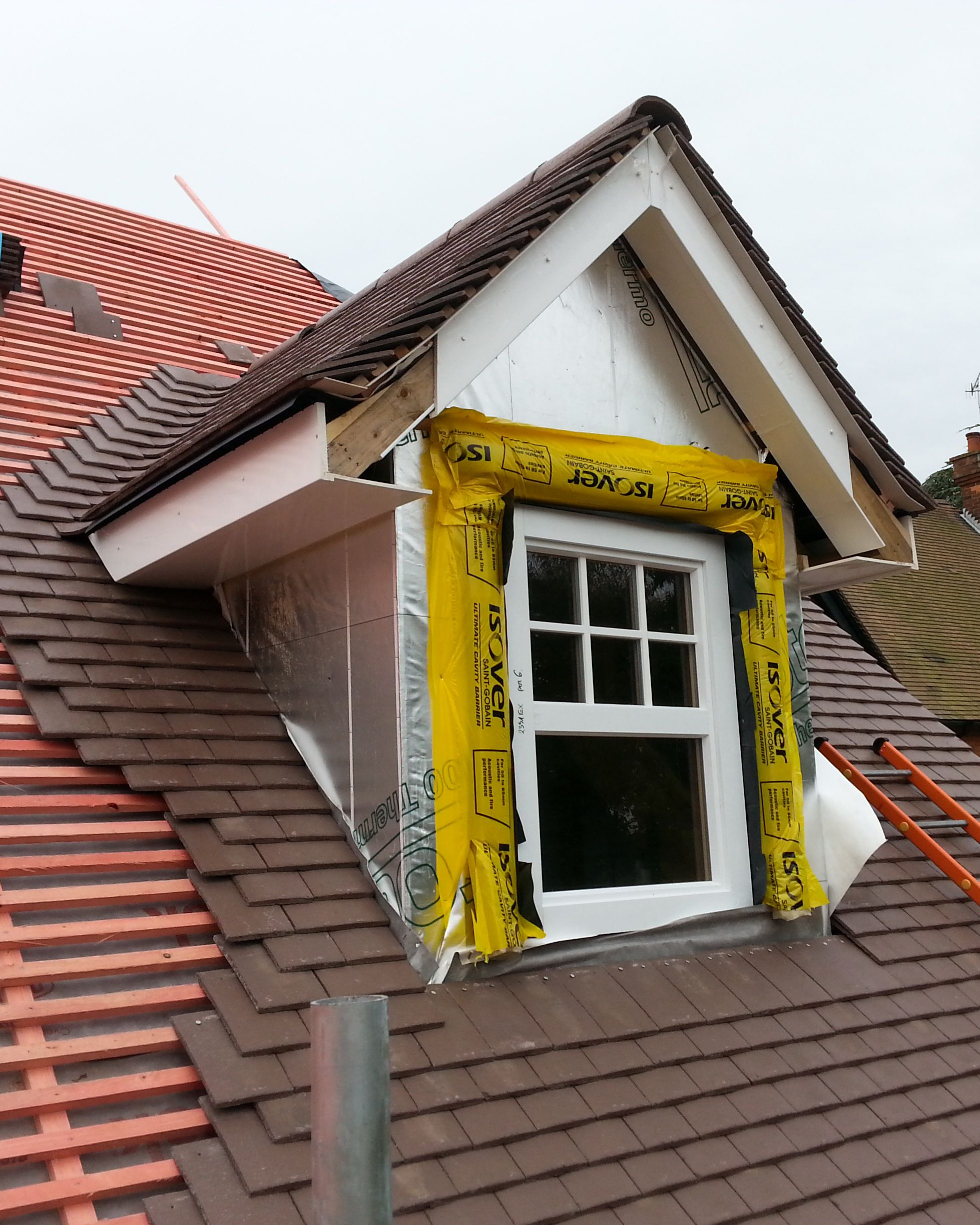 Dormer window under construction in timber frame yellow for Construction windows