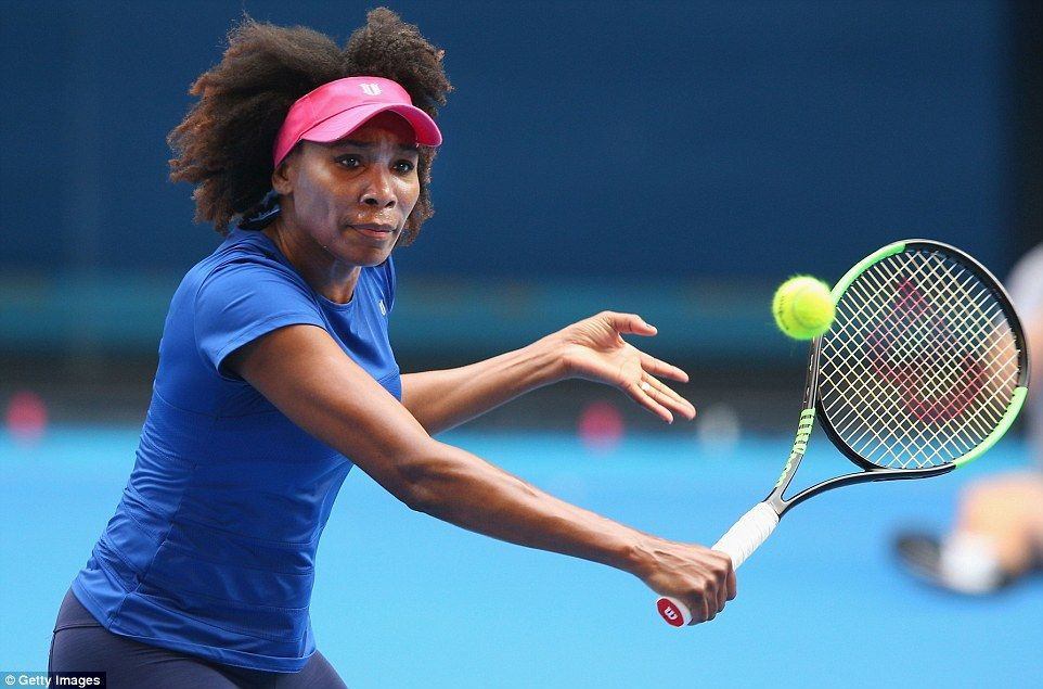 Venus Williams of the U.S. hits a backhand volley during a practice session on Tuesday