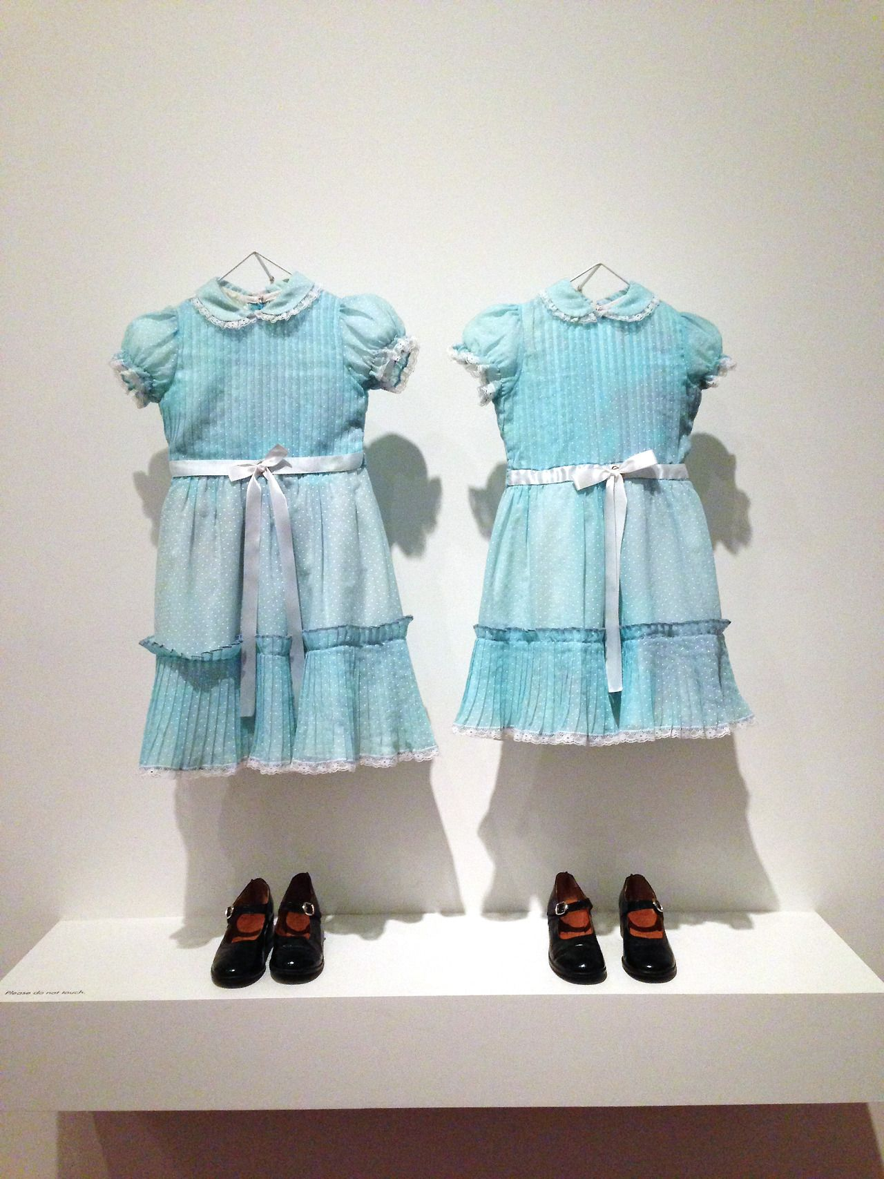 The Grady Twins Dresses And Patent Leather Shoes On Display At Los Angeles County Museum Of Art S Stanley Kubrick Exhibit