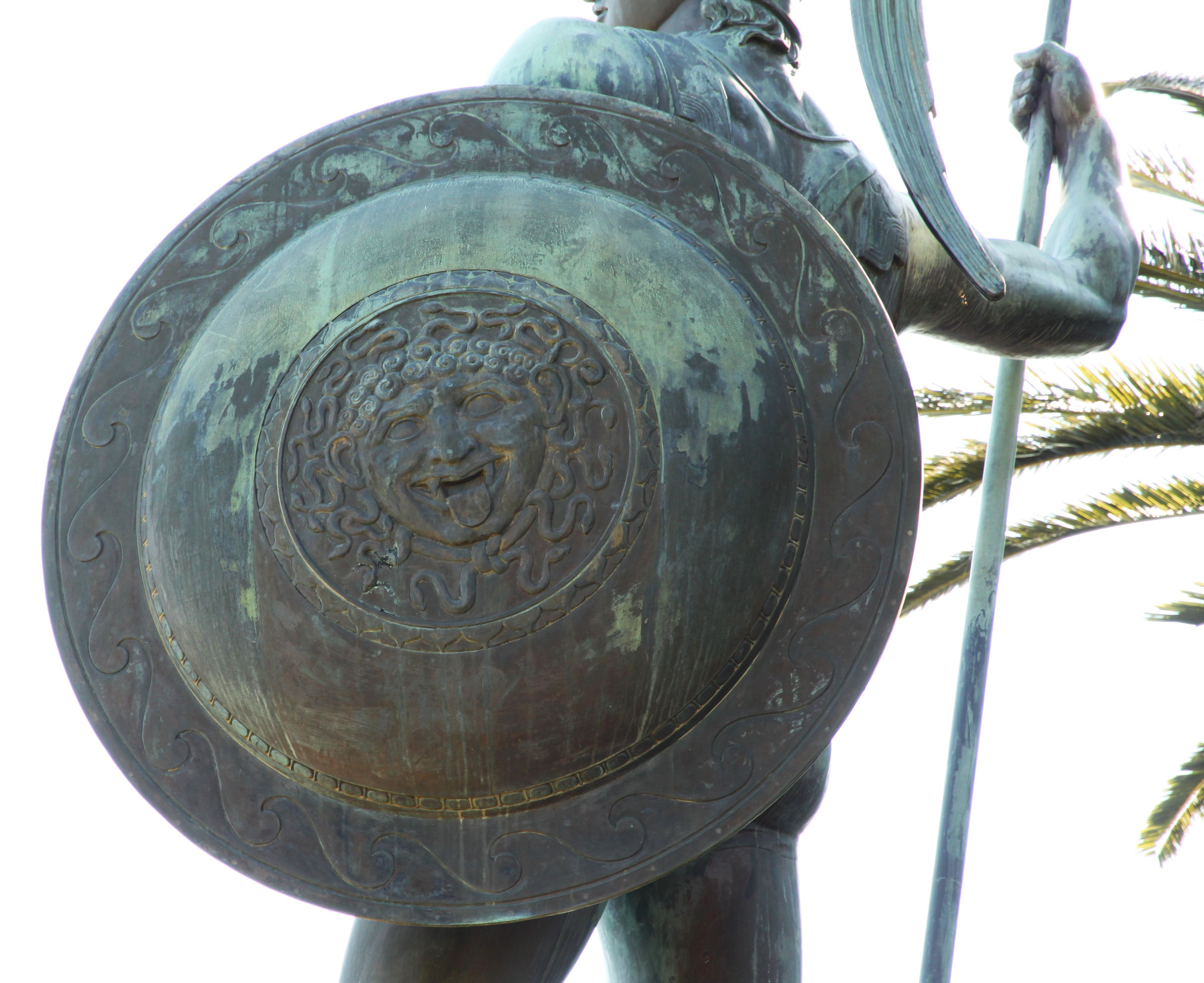 Achilles statue in full hoplite uniform with detailing such as a relief of a gorgon's head at the shield, apparently to petrify any enemies. In Greek mythology, a Gorgon refers to any of three sisters who had hair made of living, venomous snakes, as well as a horrifying visage that turned those who beheld her to stone. Traditionally, while two of the Gorgons were immortal, Stheno and Euryale, their sister Medusa was not, and she was slain by the demigod and hero Perseus. Achilles Palace…