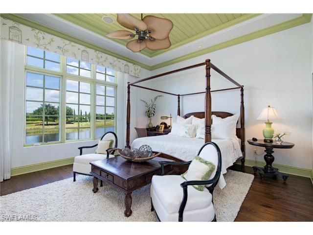 West Indies Tropical Bedroom With Dark Wood Furniture, Green Ceiling And  Wood Trim. Lucarno