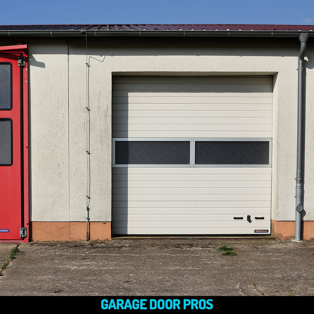 Installing A Garage Door To Your Premises Has Numerous Advantages For Your Company At The Garage Door Pros We Hav Garage Doors Commercial Garage Doors Garage