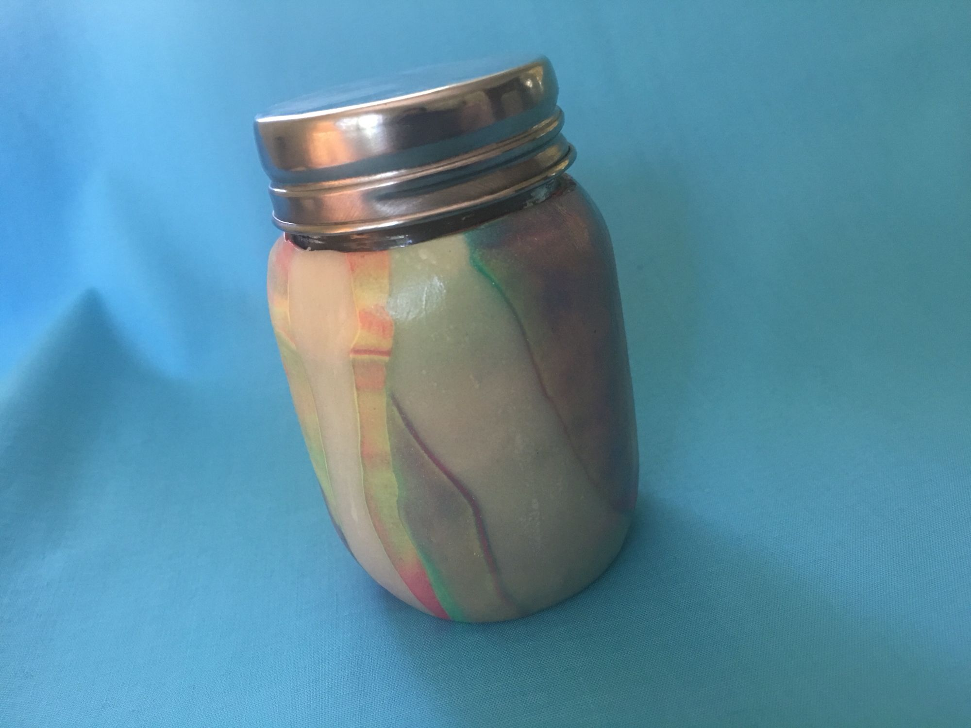 Cool jar looks like a shell sparkles in the light..
