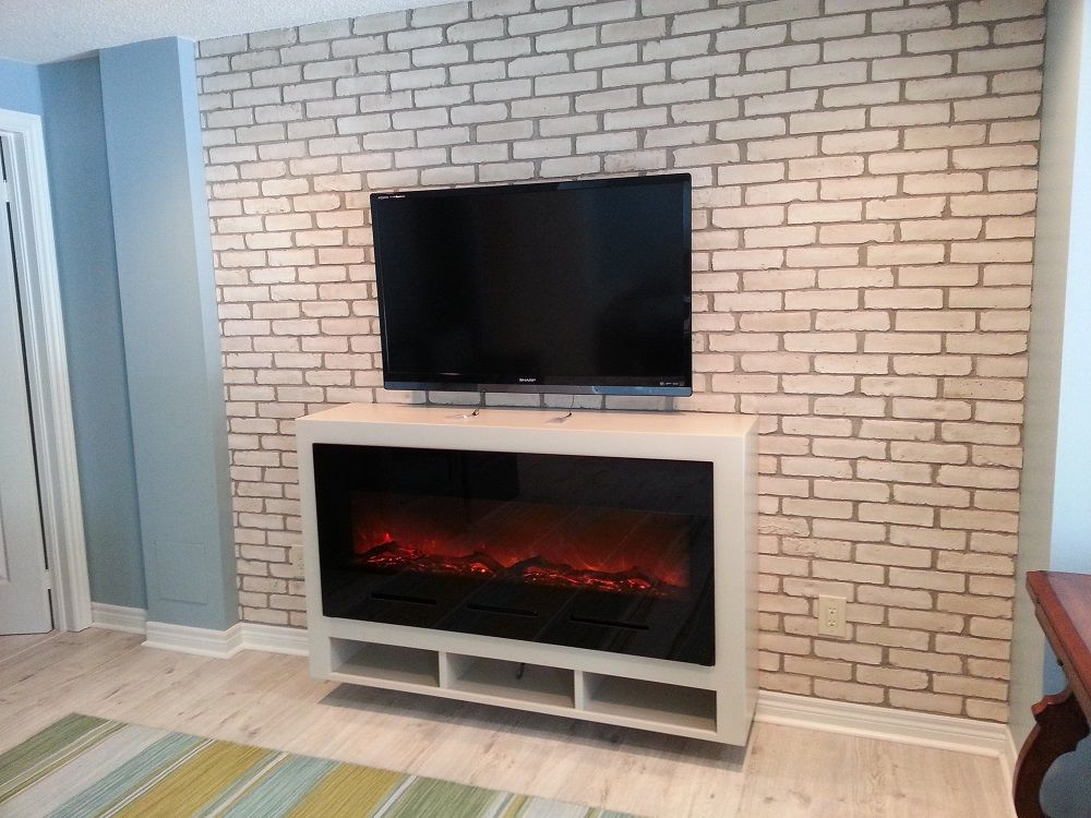 Amantii BI-50 electric fireplace in black glass, mounted in a ...