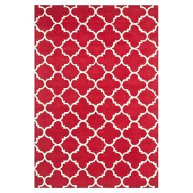 Hand-tufted in India, this lush wool rug adds a pop of Moroccan-chic style to your living room or bedroom.    Product: RugConstruction Material: WoolColor: Red and ivoryFeatures:  Hand-tuftedMade in India Note: Please be aware that actual colors may vary from those shown on your screen. Accent rugs may also not show the entire pattern that the corresponding area rugs have.Cleaning and Care: Professional cleaning recommended