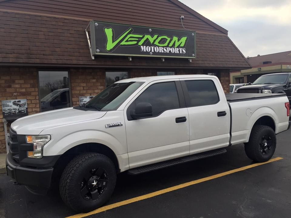 2016 Ford F 150 With A Superlift Leveling Kit Kmc Xd Rockstar 17 Wheels Toyo A T Ii Tires Extang Solid Fold Cove Husky Liners Offroad Accessories 17 Wheels