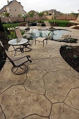 Featured in this patio and pool deck combo is a beautiful stamped concrete pattern.  Stamped concrete is a great option for resurfacing worn pool decks. Heritage Bomanite Fresno, CA