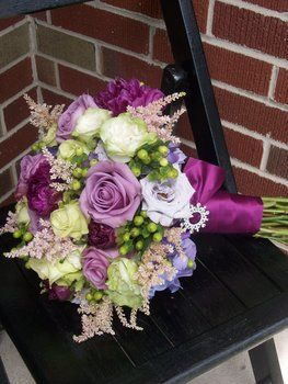 Love the assortment of flowers and colors. Love the berries and foilage.