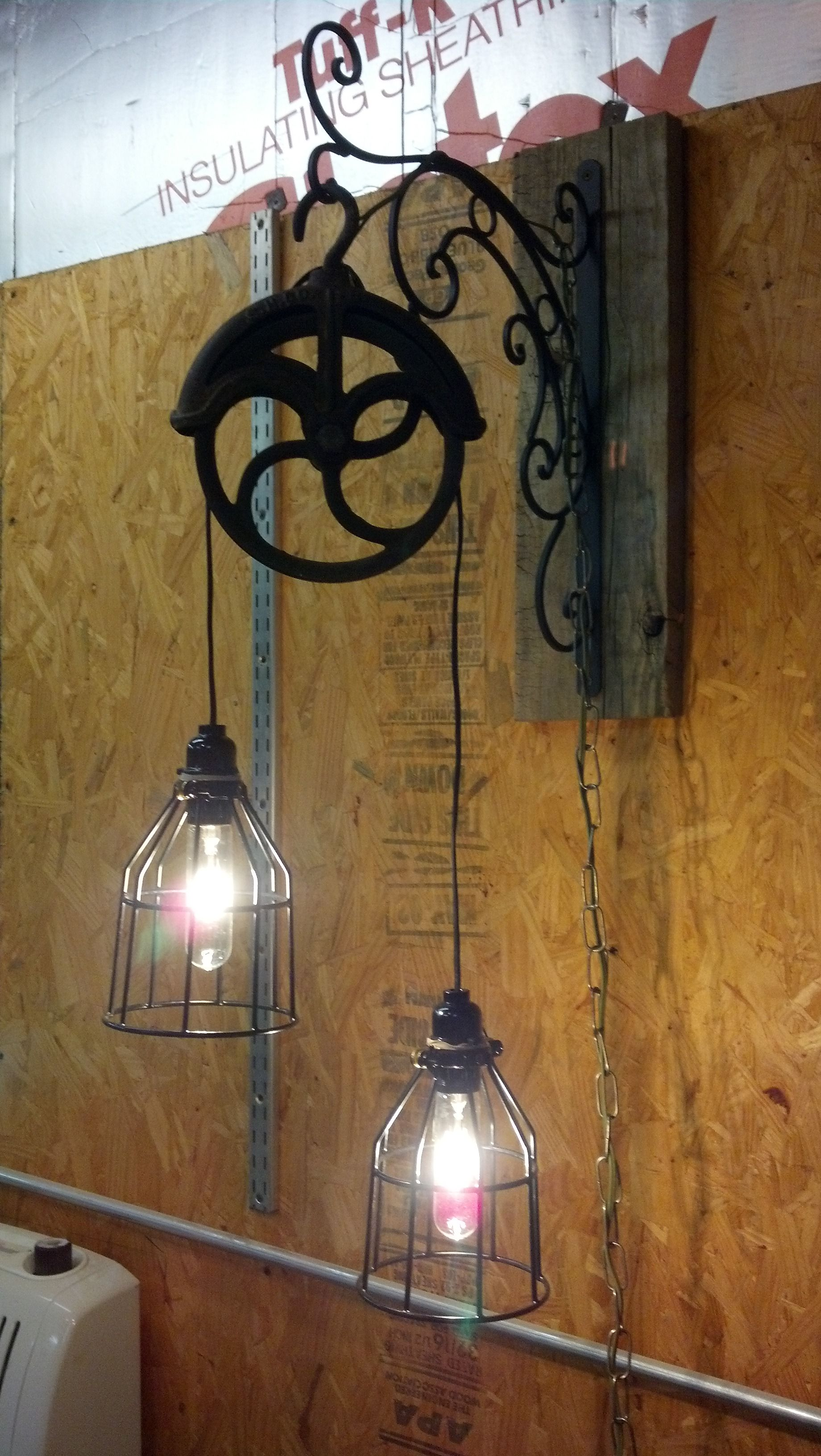 Charming Light Fixture Made From Old Pulley. LOVE PULLEYS, SO PRACTICAL AND BEAUTIFUL  WHEN USED AS SHOWN.