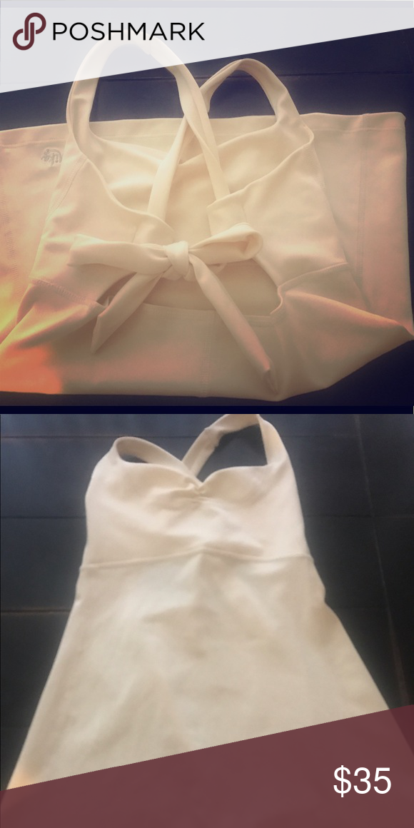 Mika Cream Yoga top size small Mika cream tank built in bra, ties in the back never worn no tags size 4 Mika Yoga Wear Tops Tank Tops