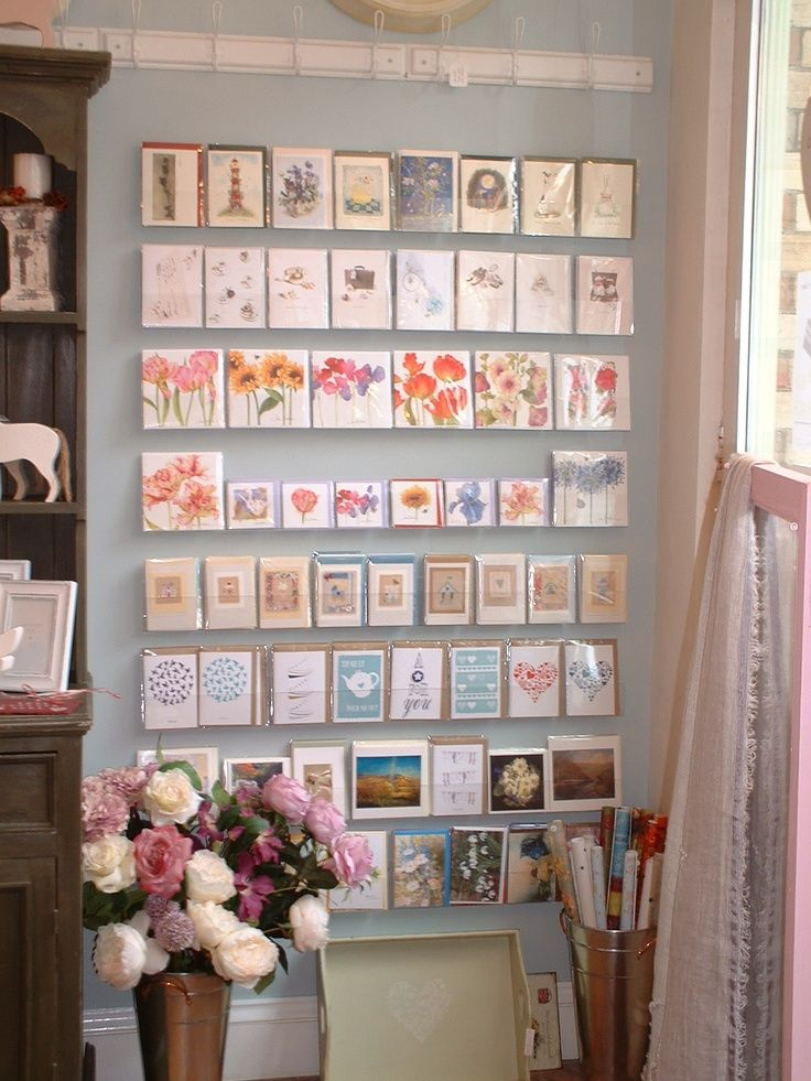 Acrylic Strips On A Painted Wall Can Make A Lovely Display When Cards Have The Same Themes Graph Gift Shop Displays Greeting Card Display Gift Shop Interiors