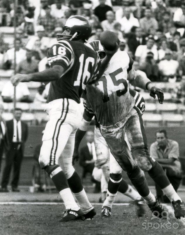 Los Angeles Rams defensive end Deacon Jones (75) pressures Philadelphia Eagles quarterback Norm Snead (16) at the Coliseum. The Rams defeated the Eagles 33-17.