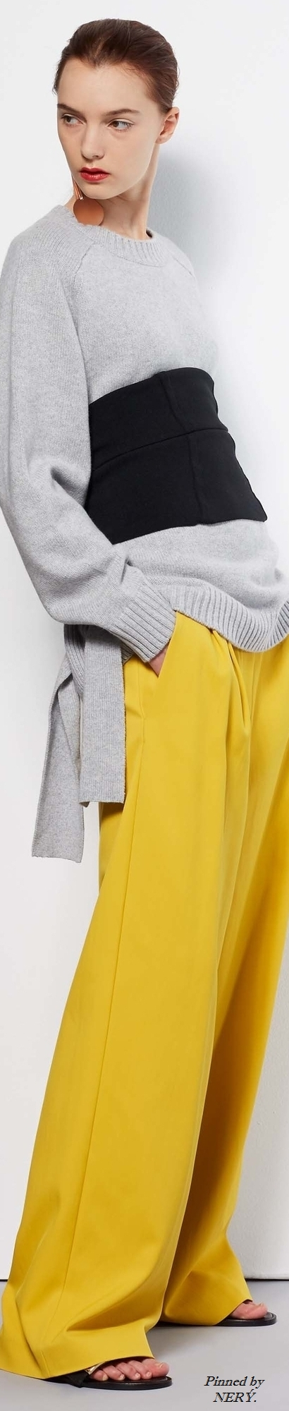 TİBİ R-17: grey sweater, black sash, yellow wide pants.