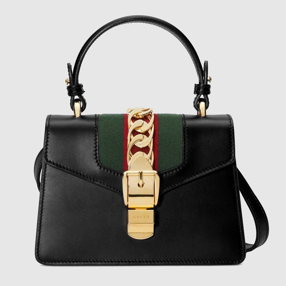2c6c2c7d45310b Shop the Sylvie leather mini bag by Gucci. The Sylvie mini bag in a top  handle shape with nylon Web embedded under the fabric and decorated with a  gold ...