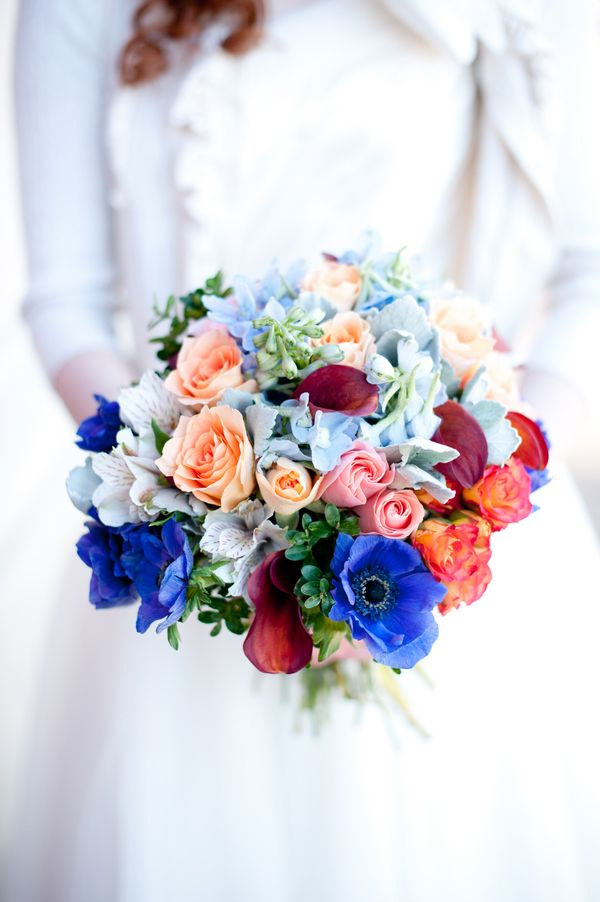 Blue anemones, maroon tulips, and pink and peach roses | Photo by Jessica Maida