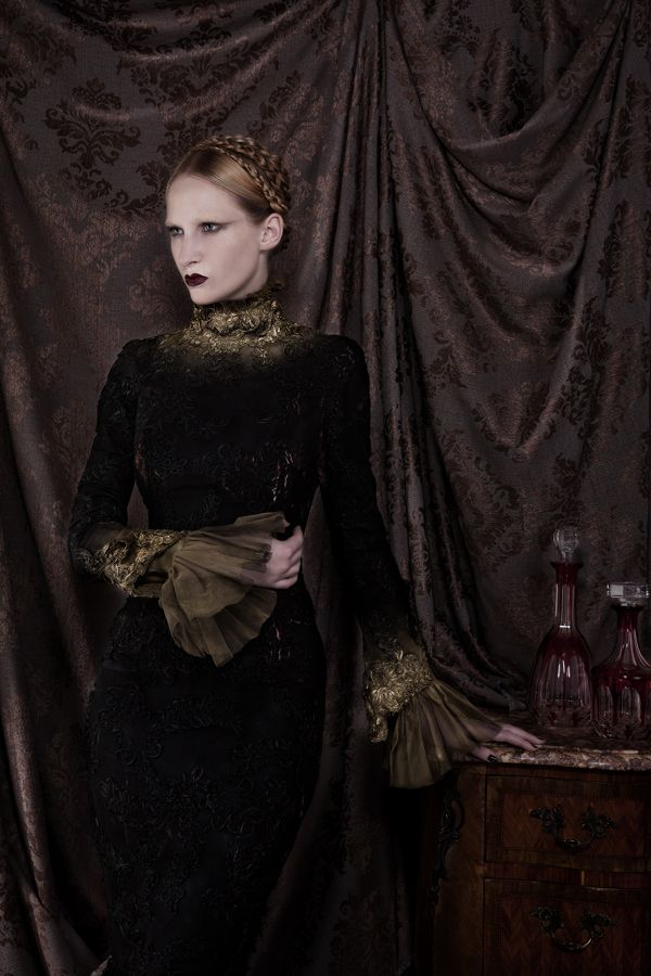 falling more and more in love with photographs containing large satin drapes either surrounding or behind a model