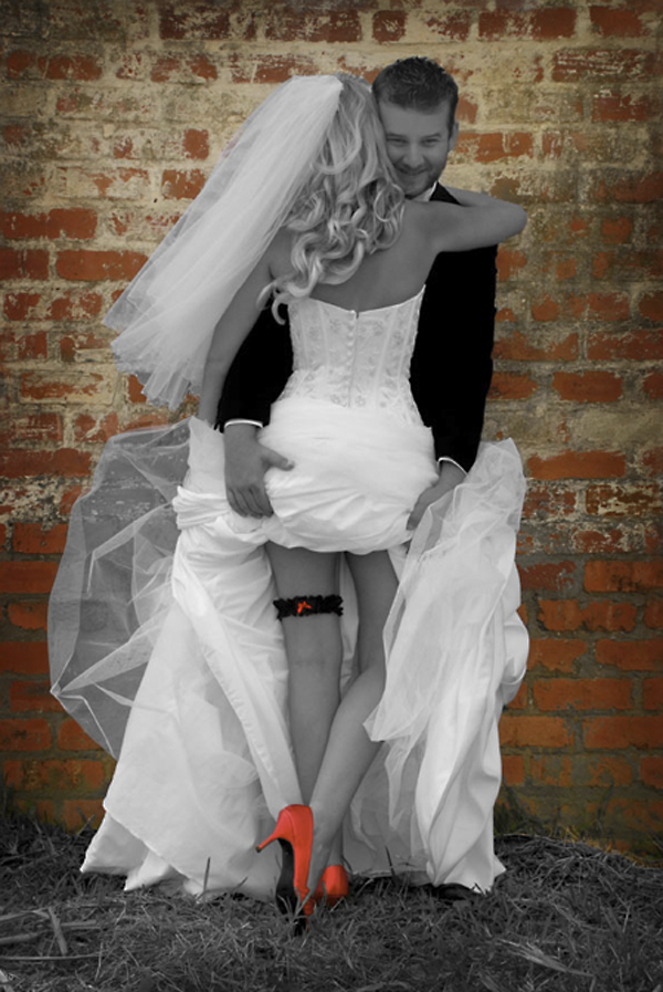 sexy wedding photo idea, bride with red shoes and groom lifting skirt