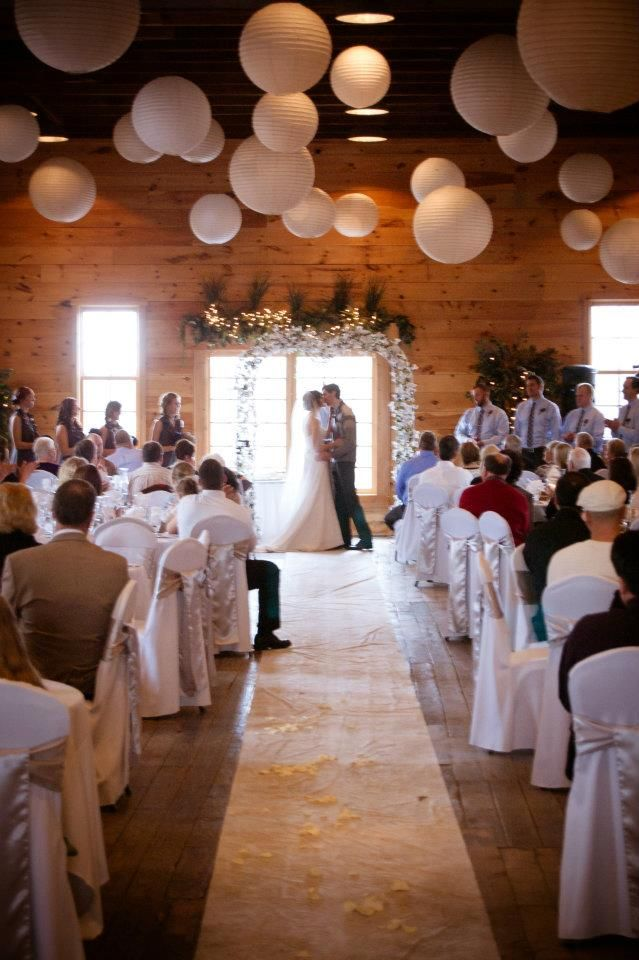 Rustic winter wedding venue people sit in tables for for Winter wedding reception ideas
