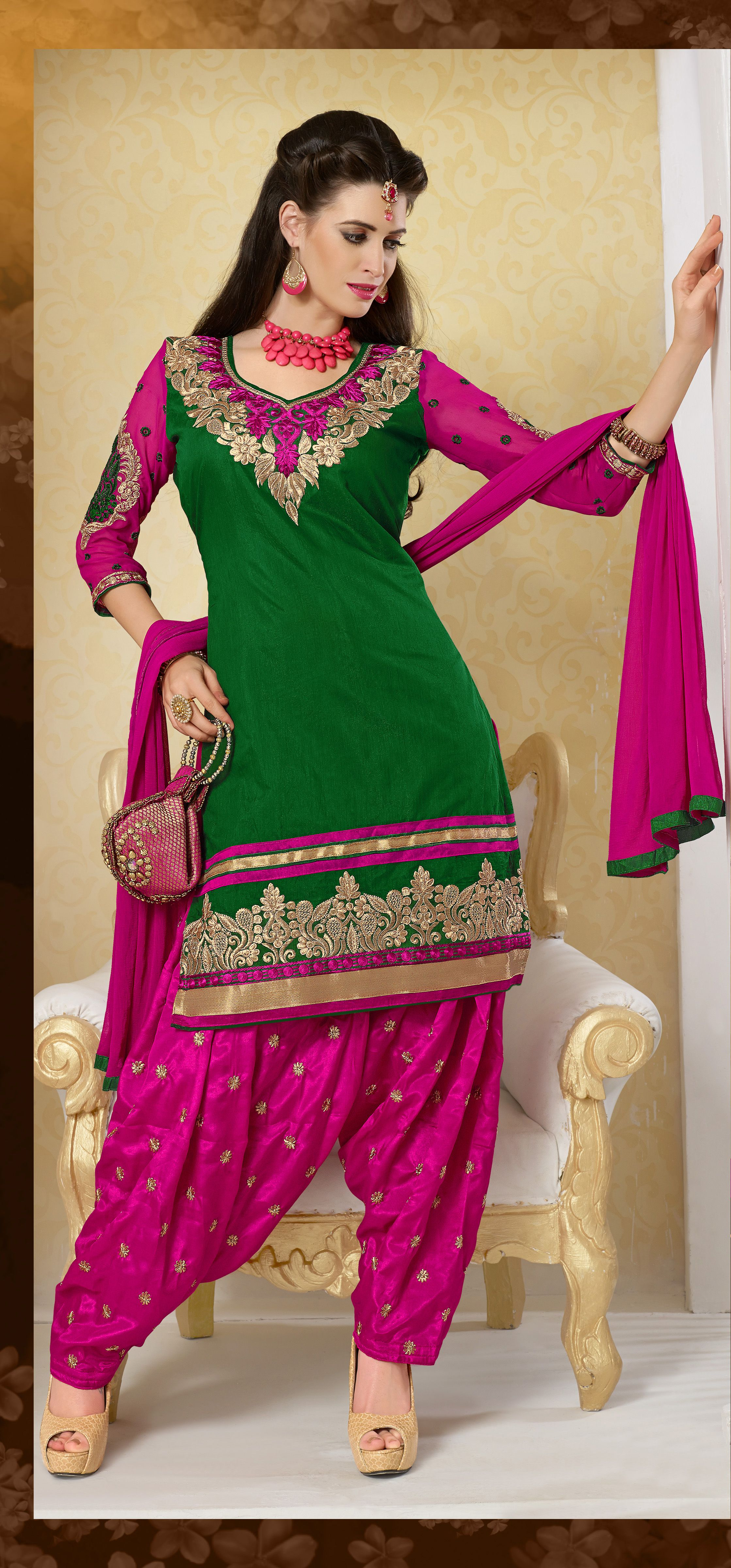 9319ddefd9 Lovely designer Punjabi Salwar suit in Green with pink great combination  comes with pink chiffon dupatta.