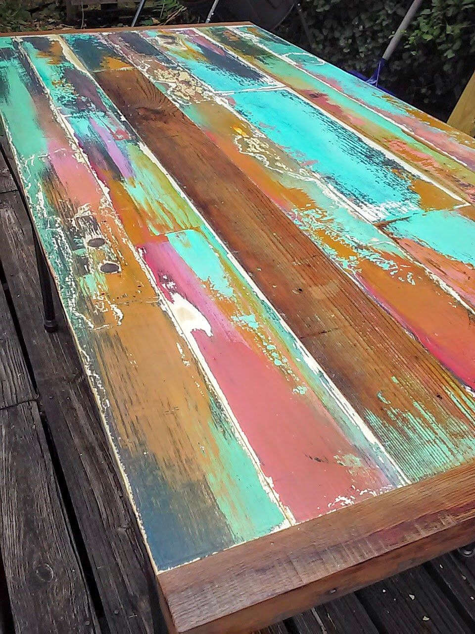 Painted reclaimed wood dining table made from a vintage door and