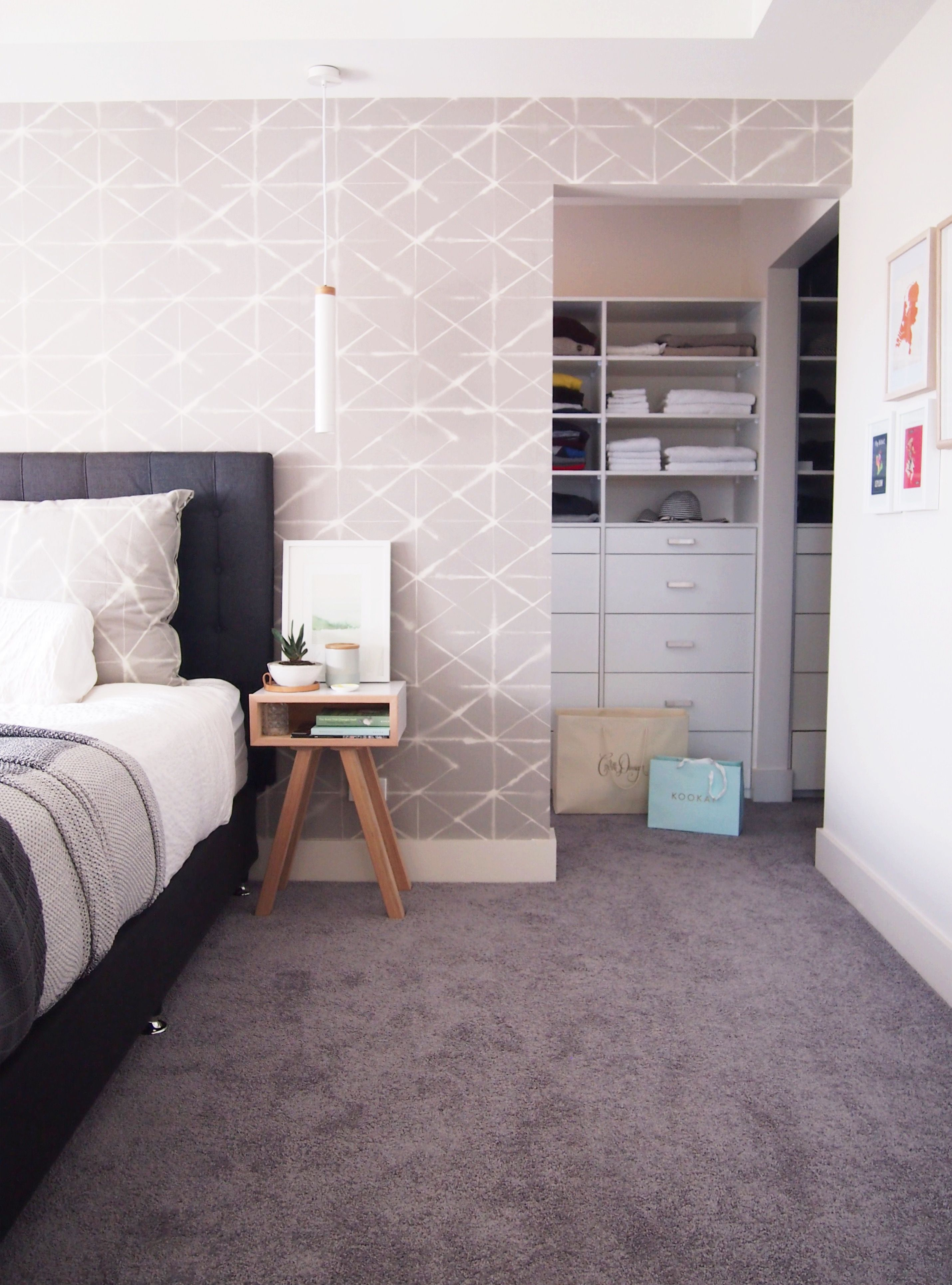 bedroom with custom wallpaper in scandinavian style walk in bedroom with custom wallpaper in scandinavian style walk in wardrobe and scandi bedside tables