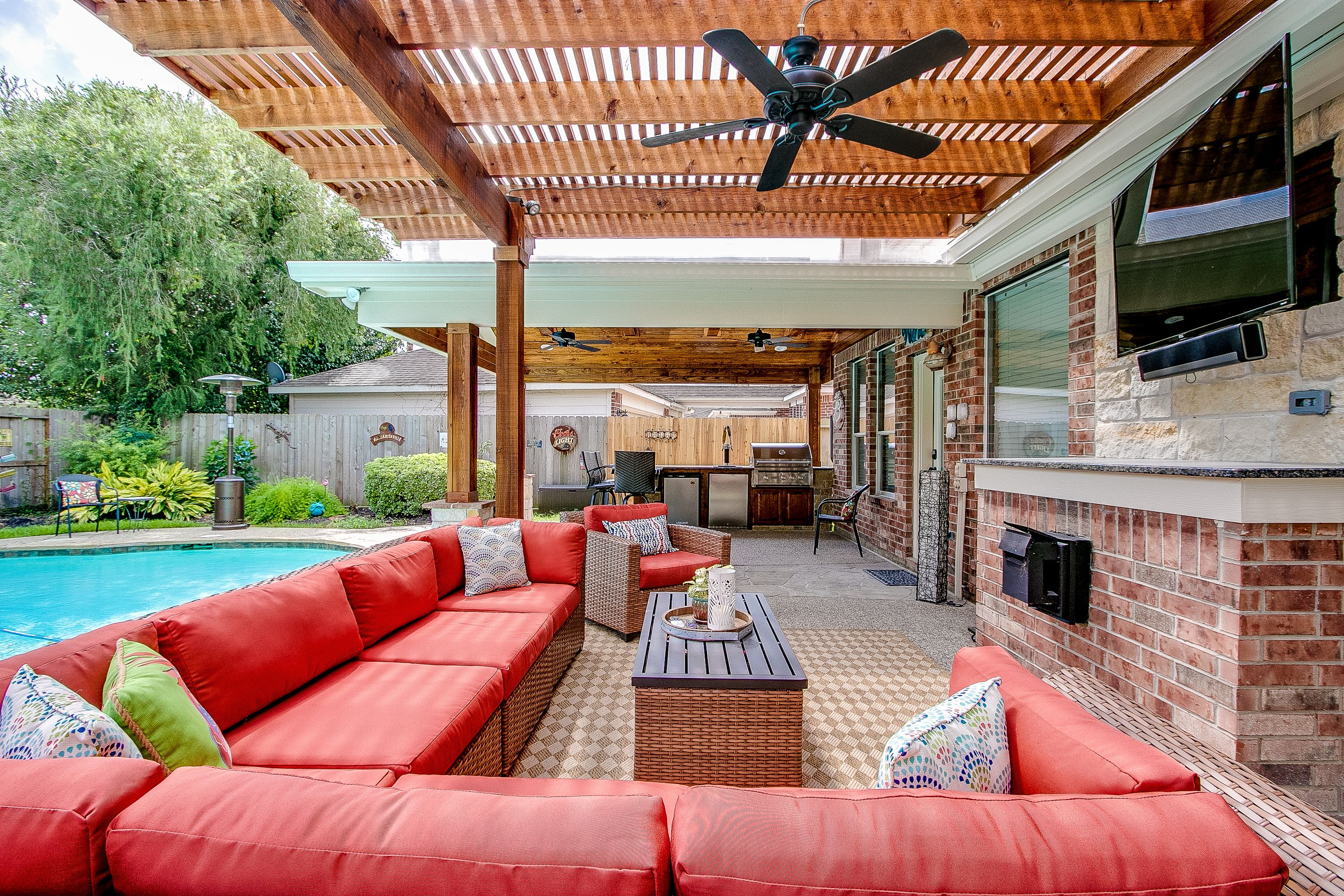 Outdoor living area with covered patio, arbor and outdoor ... on Retreat Outdoor Living id=41781