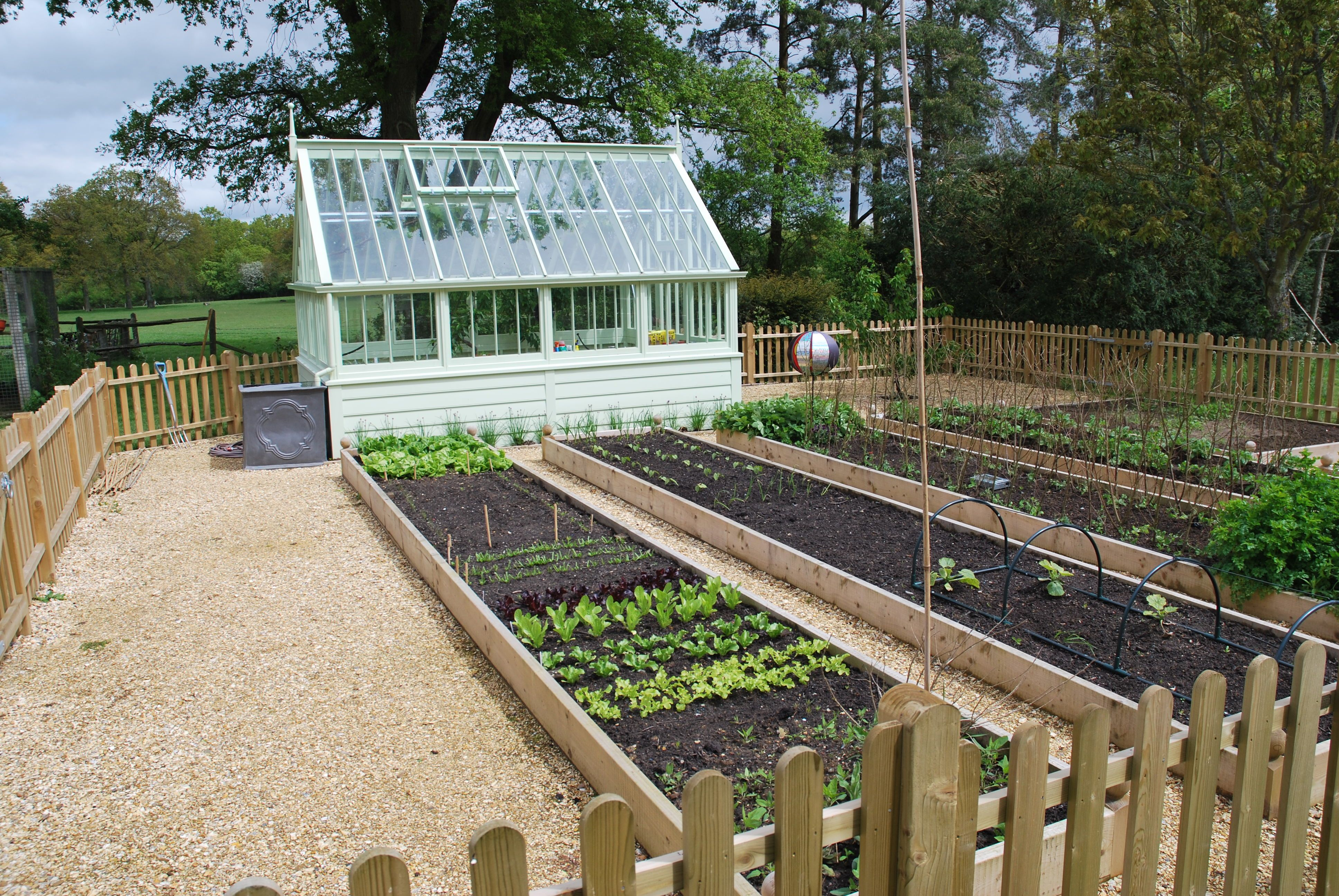 Vegetable garden with ornamental greenhouse by Nigel L ...