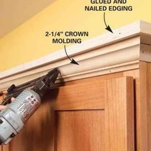 add molding + shelving to the top of your kitchen cabinets