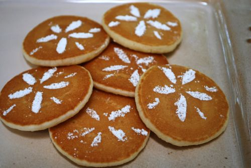 Beach retreat? DIY pancakes that look like sand dollars. Use an exact-o knife to cut the pattern out of paper, then hold the paper over each pancake (very close to it) and sprinkle powdered sugar over the paper using a sifter.